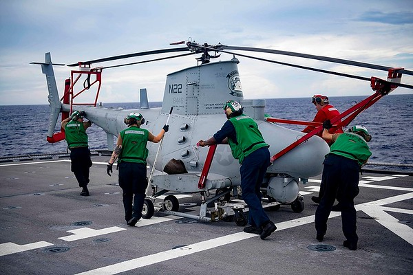 1280px-Sailors_push_an_MQ-8B_Fire_Scout_